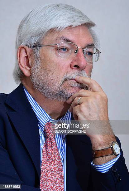 Plan Commissioner Henri Bogaert looks on during a press conference by the Central Economic Council / Conseil Central de l'Economie / Centrale Raad...