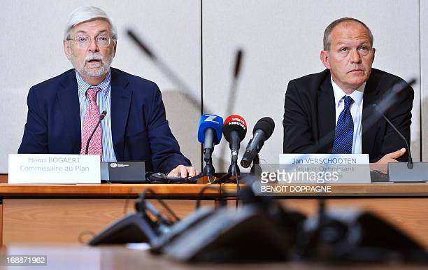 Plan Commissioner Henri Bogaert with Deputy Plan Commissioner Jan Verschooten speaks during a press conference by the Central Economic Council /...