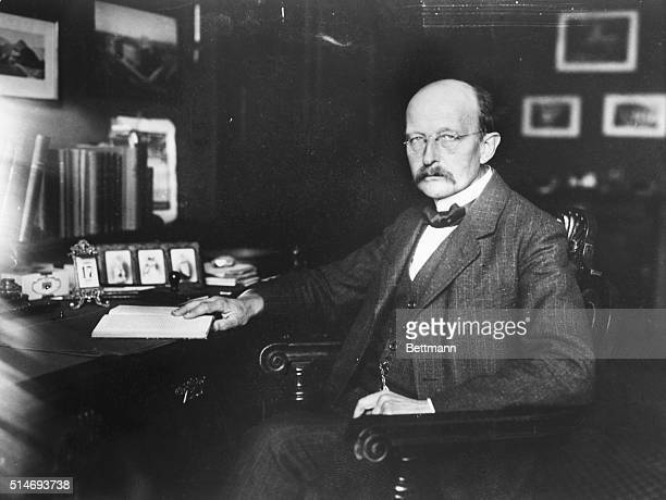 Planck, Max , German physicist. Planck seated in his office at a desk. Photograph, 1919.