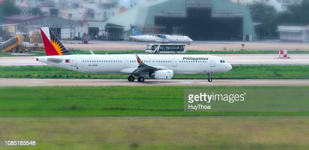 plane airbus a321 of philippine airlines prepare take off from tan son nhat international airport - filipino flag stock pictures, royalty-free photos & images