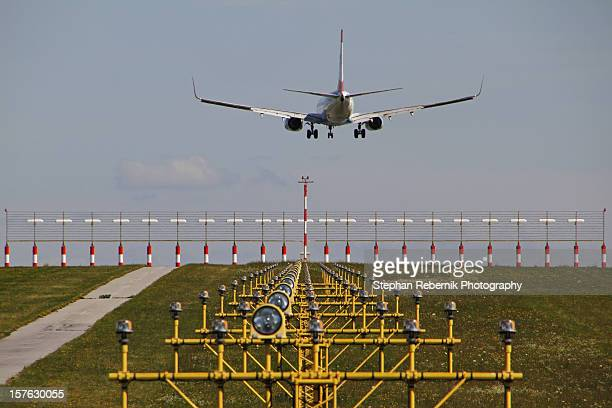 a plane approaching the runway - stephan rebernik ストックフォトと画像