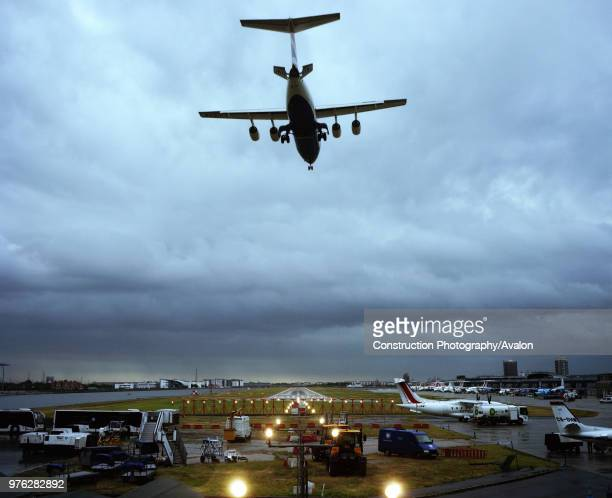 Plane arriving at London City Airport, shot from Connaught Cross, London, UK.