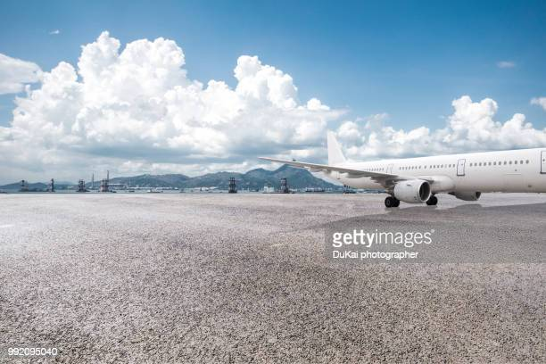 a plane at the airport - airfield stock pictures, royalty-free photos & images