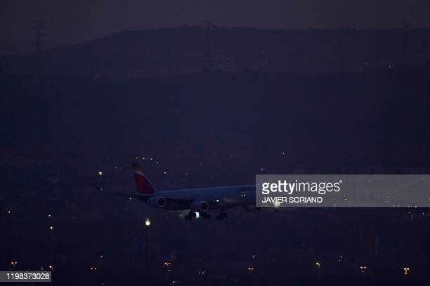 A plane by Spain's flagship carrier Iberia lands at MadridBarajas Adolfo Suarez Airport on February 03 2020 in Madrid An Air Canada flight was due to...