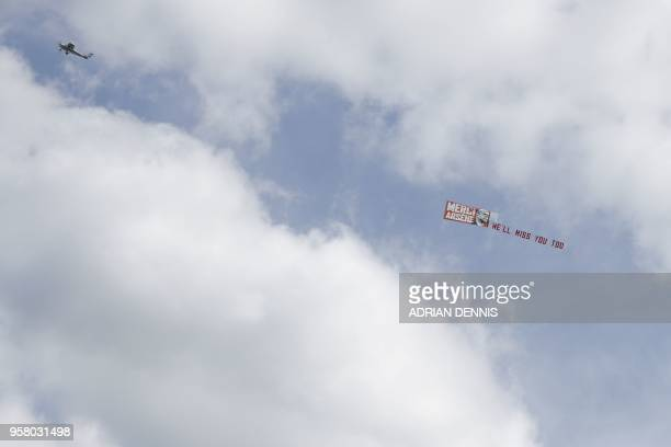 TOPSHOT A plane carries a banner bidding farwell to Arsenal's French manager Arsene Wenger before the English Premier League football match between...