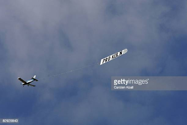 A plane carry a promotion banner of the far right Pro Koeln on September 20 2008 in Cologne Germany The far right Pro Koeln expected for the rally...