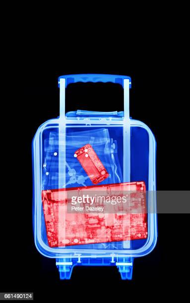 plane carry on luggage with laptop inside - security scanner stock pictures, royalty-free photos & images