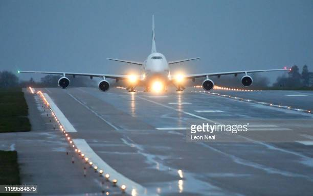 A plane carrying 150 Britons who were trapped in Wuhan following a Coronavirus outbreak lands at RAF Brize Norton from China on February 9 2020 in...