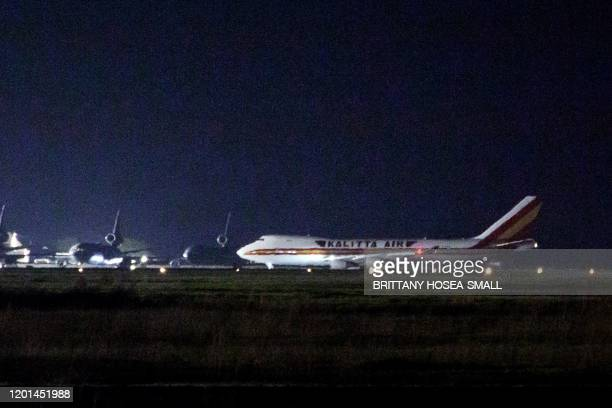 Plane carrying American passengers, who were recently released from the Diamond Princess cruise ship in Japan, arrives at Travis Air Force Base in...