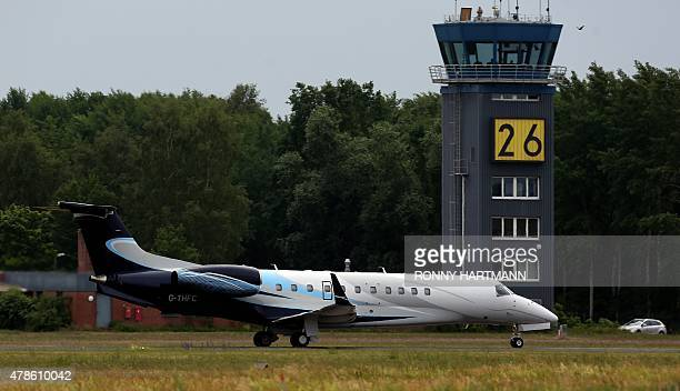 A plane carrying Britain's Queen Elizabeth II and Britain's Prince Philip Duke of Edinburgh leaves the military airport in Celle for London on June...