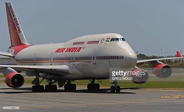 A plane carrying Narendra Modi Prime Minister of India arrives at Brisbane Airport for the G20 Leader's Summit on November 14 2014 The G20 Leader's...
