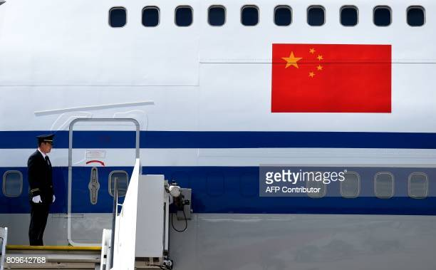 A plane carrying onboard China's President stands on the tarmac after he arrived at the airport in Hamburg northern Germany on July 6 to attend the...