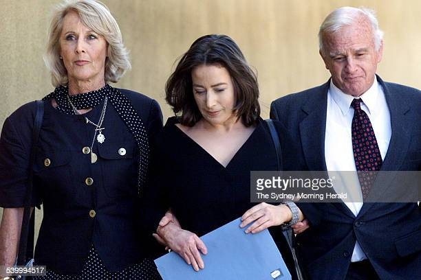 Plane crash survivor Victoria Friend centre her mother Jill left and father Alan leave Glebe Coroner's Court Friend was badly burned in January 1999...