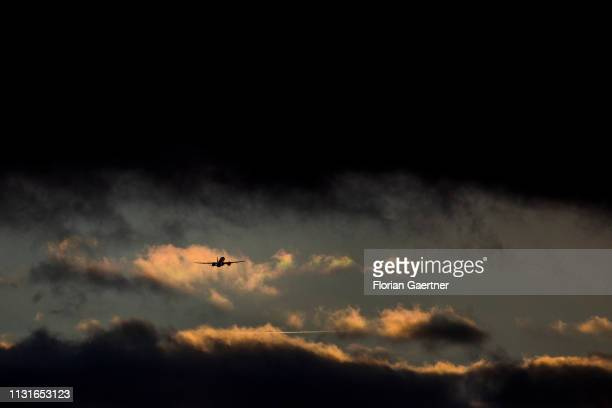 A plane departures from Tegel TXL airport during sunset on March 19 2019 in Berlin Germany