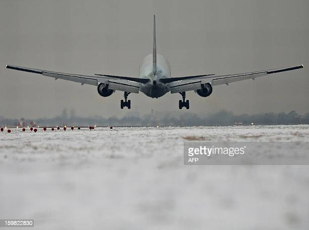 A plane flies in to land at Heathrow airport in west London on January 21 2013 after the airport announced further flight cancellations due to...
