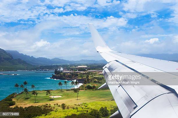 a plane flies into lihue airport - hawaii islands stock pictures, royalty-free photos & images