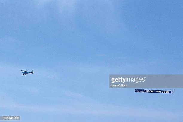 A plane flies over Copacabana Beach trailing a 'Laureus Sport For Good' banner during day 1 of the 2013 Laureus World Sports Awards on March 92013 in...