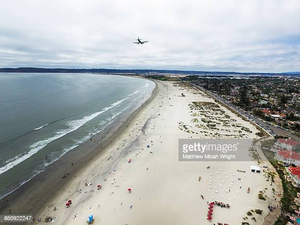 A plane flies over Coronado Beach.