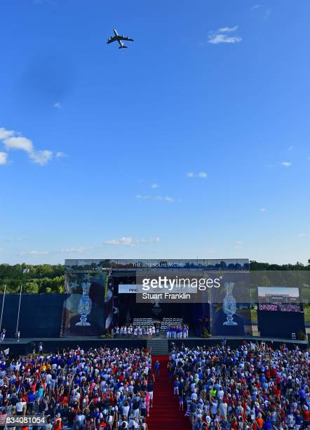A plane flies over during the opening ceremony prior to the start of The Solheim Cup at Des Moines Golf and Country Club on August 17 2017 in West...