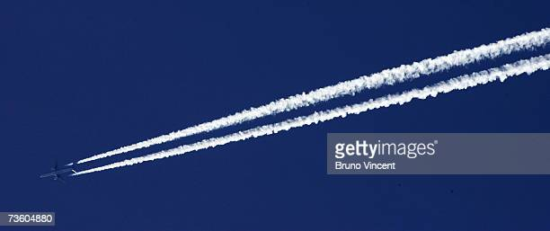 A plane flies over London on March 16 2007 in London A US government agency has announced that winter in the Northern Hemisphere this year has been...