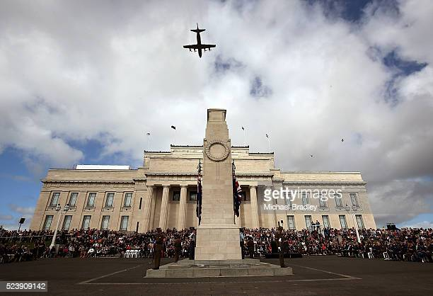 A plane flies over the Auckland Museum on April 25 2016 in Auckland New Zealand New Zealanders are commemorating 101 years since the Australian and...