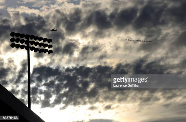 A plane flies over the ground with a GO BURNLEY banner prior the Barclays Premier League match between Burnley and Manchester United at Turf Moor on...
