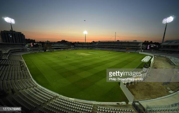 Plane flies over the ground with no spectators attending during the Vitality T20 Blast match between Middlesex and Surrey at Lord's Cricket Ground on...