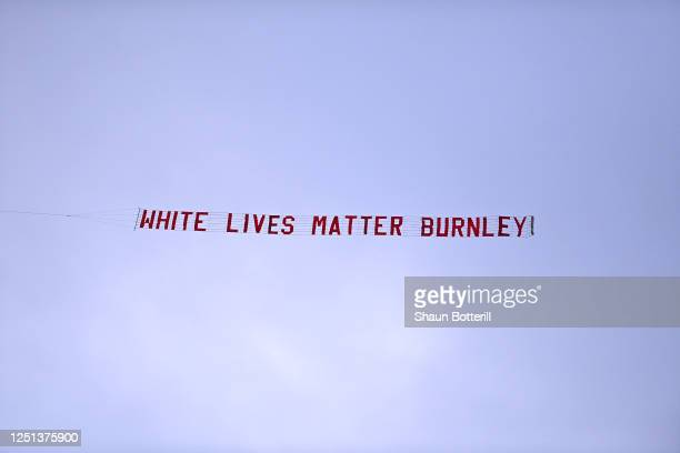 A plane flies over the stadium with a banner reading 'White Lives Matter Burnley' during the Premier League match between Manchester City and Burnley...