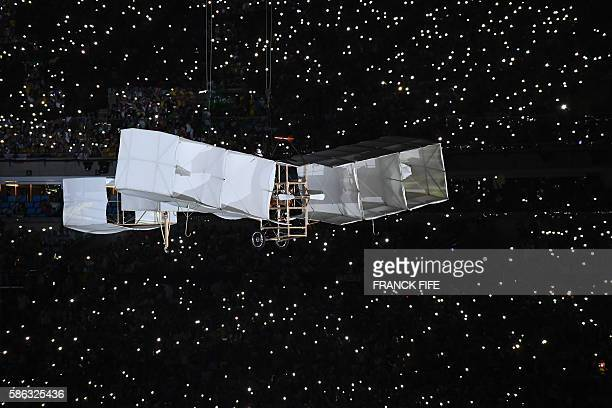 A plane flies over the stage during the opening ceremony of the Rio 2016 Olympic Games at Maracana Stadium in Rio de Janeiro on August 5 2016 / AFP /...