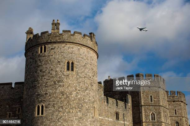 A plane flies over Windsor Castle on January 5 2018 in Windsor England British Prime Minister Theresa May has publicly challenged comments made by...