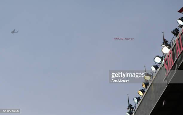 A plane flies overhead with a banner criticising Manchester United Manager David Moyes during the Barclays Premier League match between Manchester...