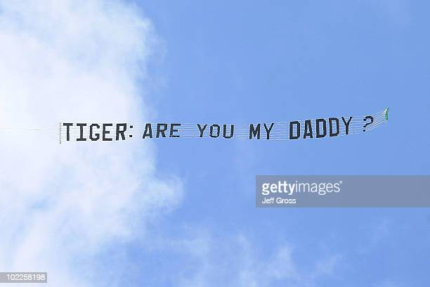 A plane flies with a banner stating 'Tiger are you my daddy' during the final round of the 110th US Open at Pebble Beach Golf Links on June 20 2010...
