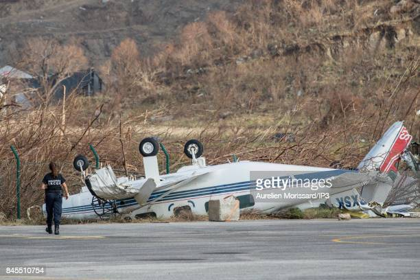 A plane flipped on its back at the airport of Saint Martin after the passage of the hurricane IRMA through the Caribbean Islands on September 10 2017...