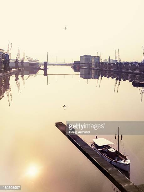 Plane flying over Royal Victoria Docks, London, UK