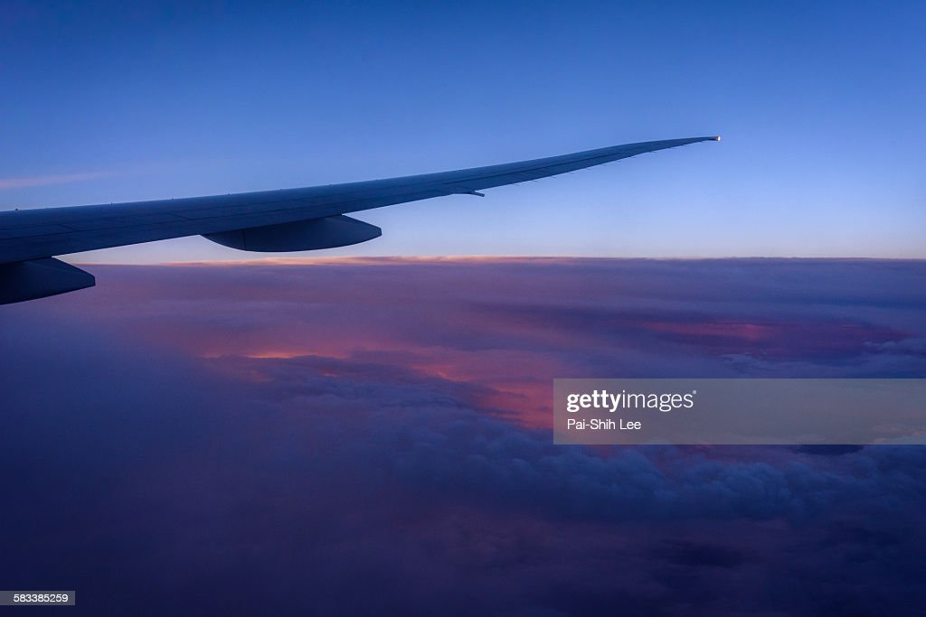 A plane flying over the cloud : Stock Photo