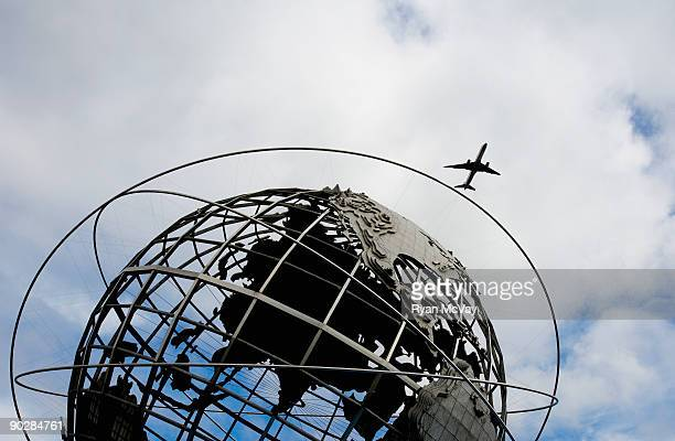 Plane flying over World's Fair Globe, New York