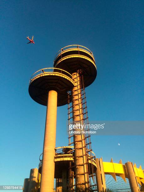 plane flying past historic 1964 worlds fair new york state pavilion, queens, ny - flushing queens stock pictures, royalty-free photos & images