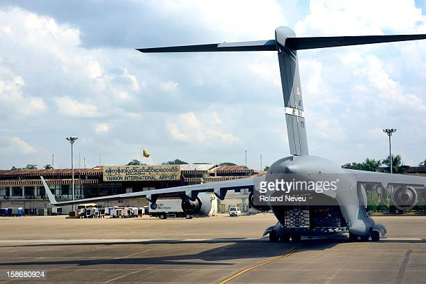 A plane form the United State Military sits on the tarmac of the Yangon airport it was part of the support team during the President Barack Obama...