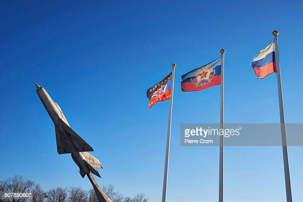 A plane from the former Soviet Union and flags from Donetsk People's Republic Luhansk People's Republic Russia on January 4 2016 in Krasnodon Over...