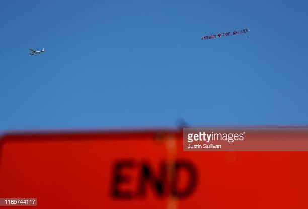 """Plane hired by Media Matters pulls a banner that reads """"Facebook loves right wing lies"""" as it flies over Facebook headquarters on November 05, 2019..."""