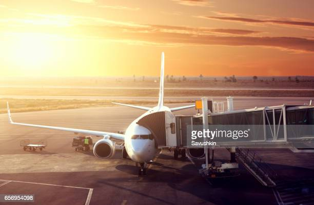 plane in airport - airfield stock pictures, royalty-free photos & images