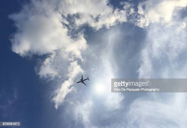 Plane in dramatic cloud filled sky