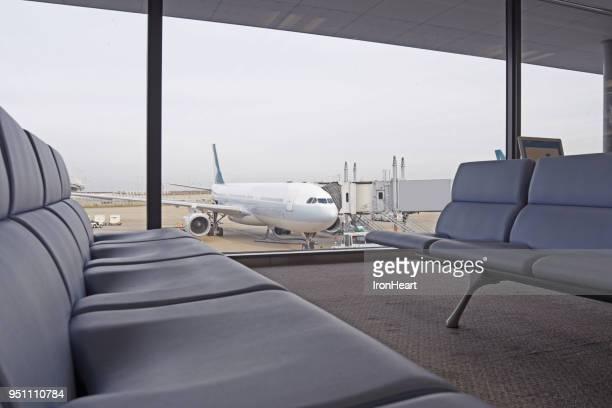 plane in the airport. - abflugbereich stock-fotos und bilder