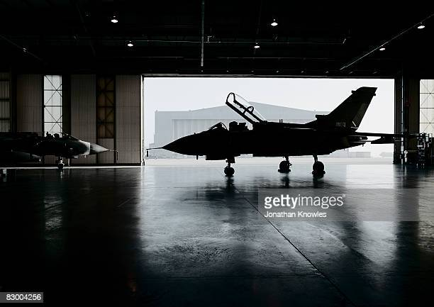plane inside aircraft hanger  - military airplane stock pictures, royalty-free photos & images