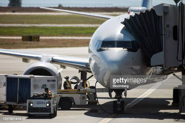 Plane is loaded on the tarmac at Vancouver International Airport in Vancouver, British Columbia, Canada, on Tuesday, Aug. 4, 2020. Data from security...