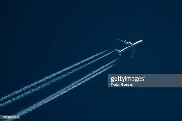A plane is pictured above the airport Schoenefeld on September 29 2017 in Berlin Germany