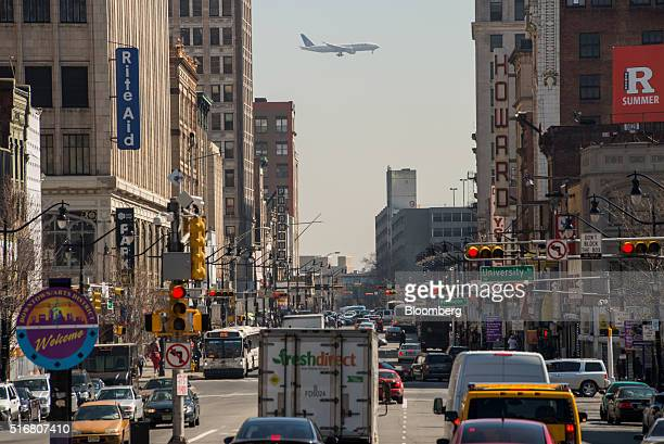 A plane is seen flying over Market Street heading towards Newark International Airport in Newark New Jersey US on Wednesday March 9 2016 New Jersey's...