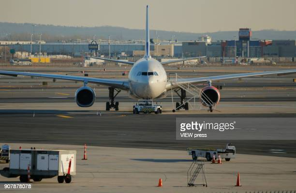 A plane is seen on the tarmac at Newark airport on January 18 2018 in Newark New Jersey NASA researchers said that 2017 was the secondwarmest year on...