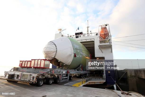A A380 plane is transferred off a ship onto a barge at Paulliac harbour in France where it will sail down a river before completing the journey to...