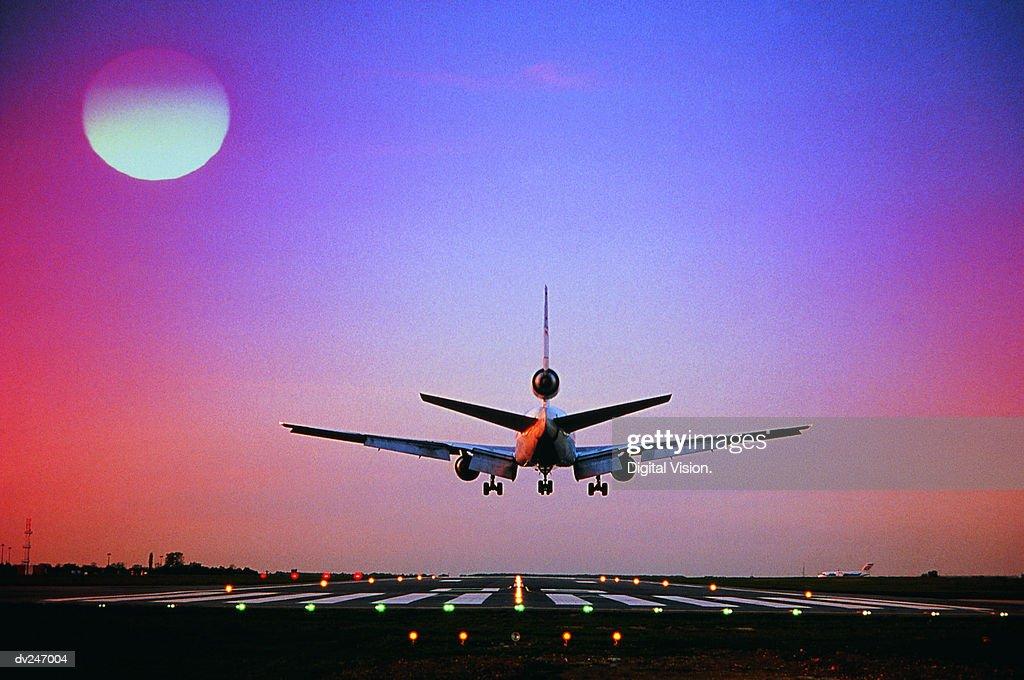 Plane landing on runway : Stock Photo
